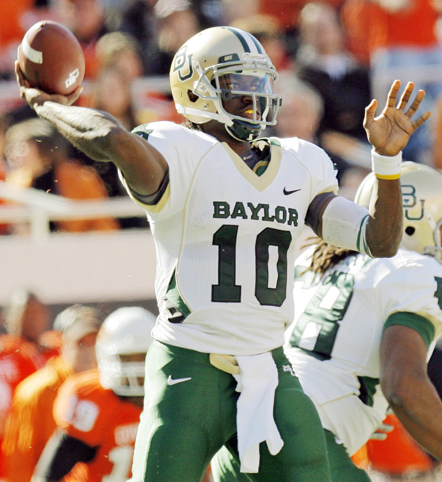 Photo - Baylor's Robert Griffin III (10) passes the ball during the college football game between the Oklahoma State University Cowboys (OSU) and the Baylor University Bears at Boone Pickens Stadium in Stillwater, Okla., Saturday, Nov. 6, 2010. Photo by Nate Billings, The Oklahoman