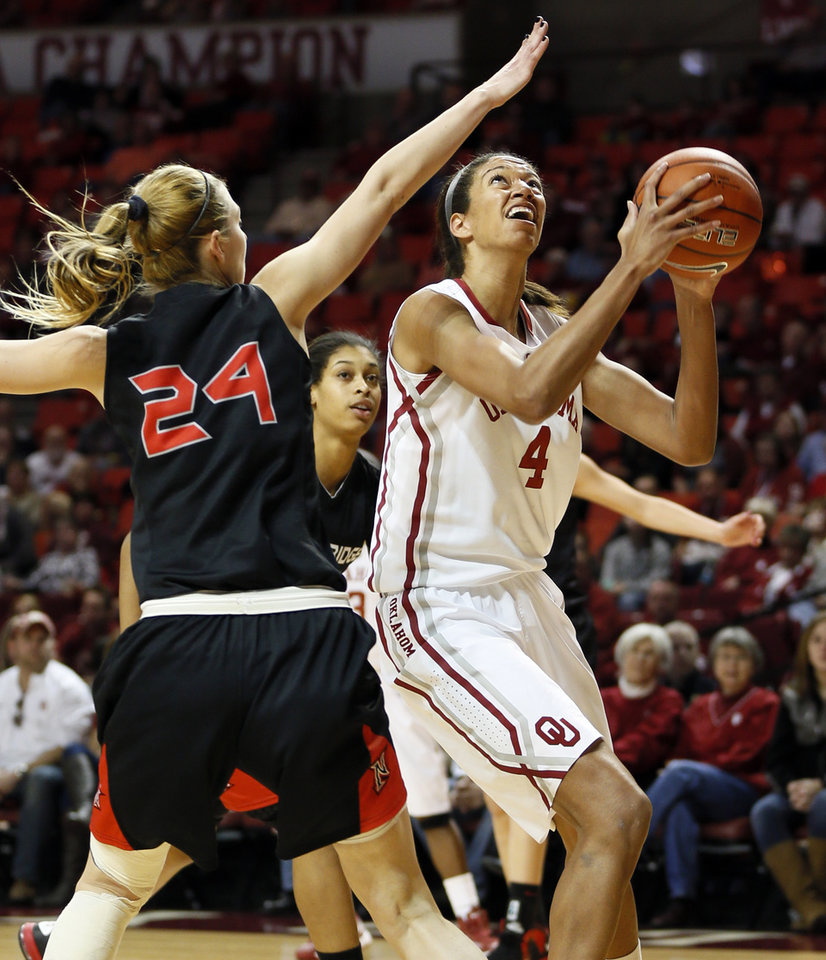 Photo - Oklahoma's Nicole Griffin (4) shoots next to Cal State Northridge's Marta Masoni (24) in the first half during a women's college basketball game between the University of Oklahoma (OU) and Cal State Northridge at the Lloyd Noble Center in Norman, Okla., Saturday, Dec. 29, 2012. Photo by Nate Billings, The Oklahoman