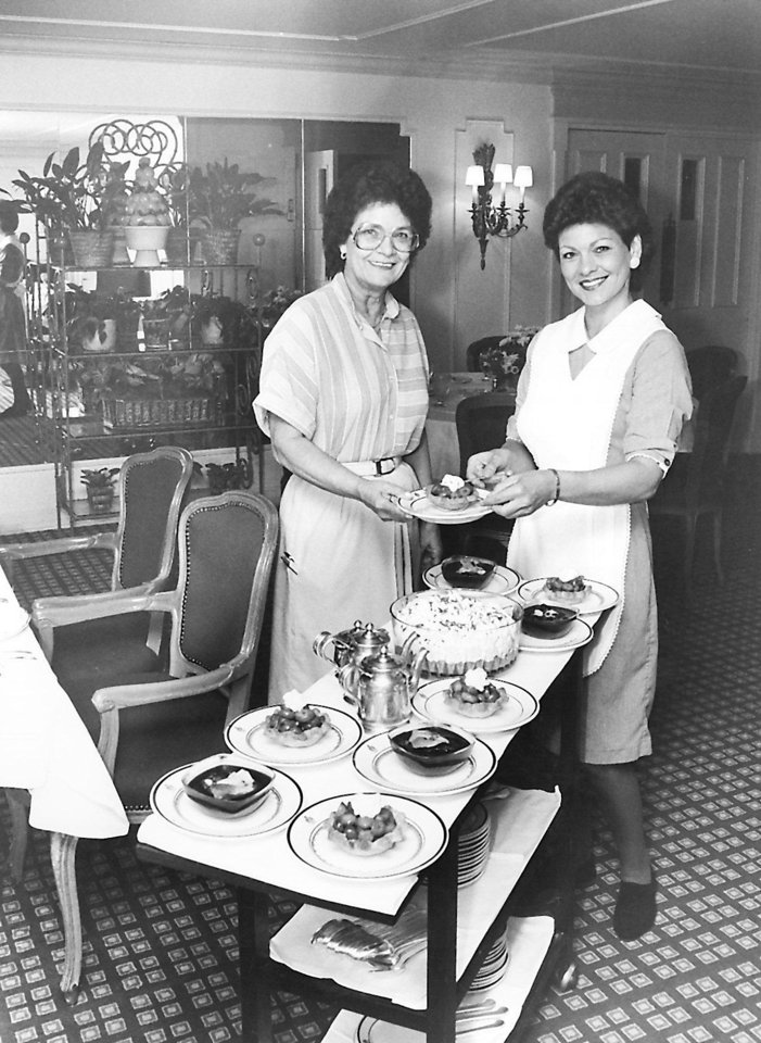 Photo - The dessert cart was a familiar part of the dining experience at The Cellar in the Hightower Building downtown. Norma Mize, left, and Terrie Stanton show off the dessert selection from this 1983 photo. (Original photo taken 10/19/83)