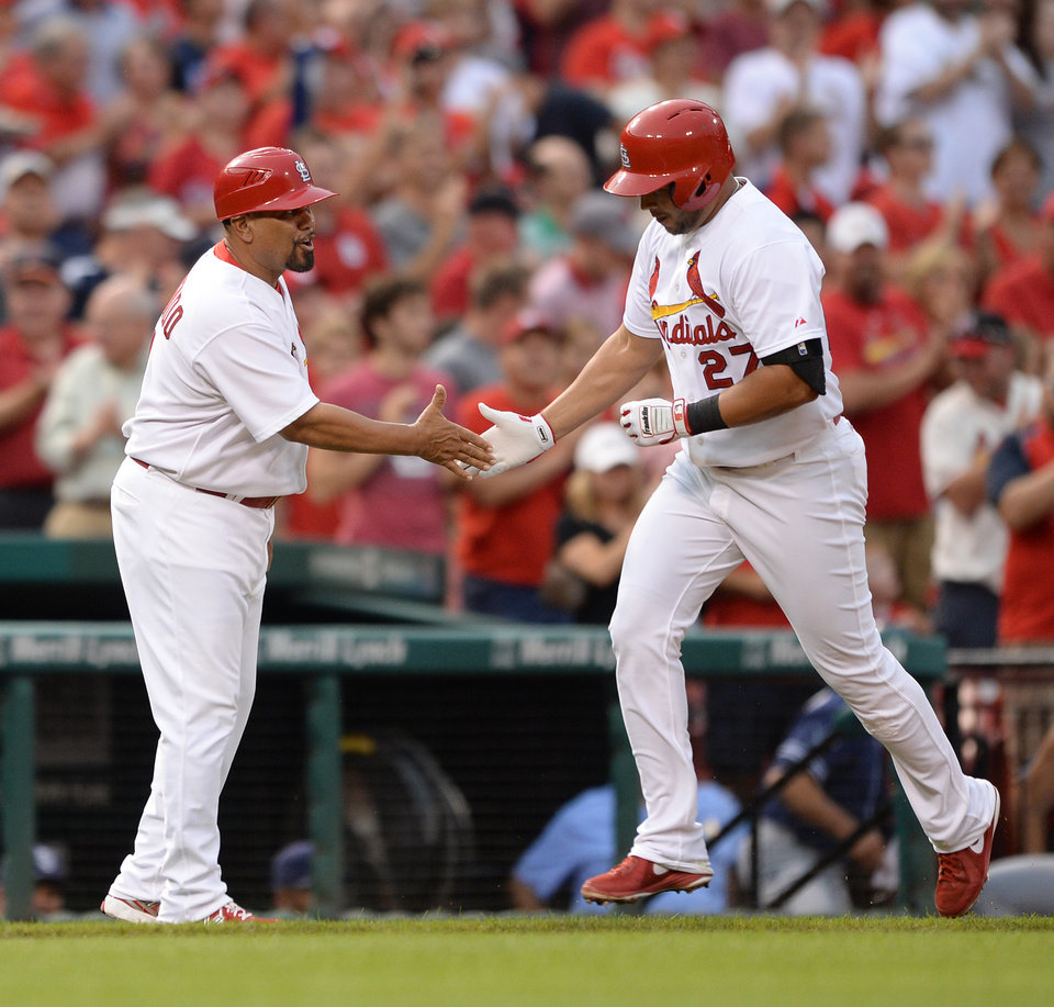 Photo - St. Louis Cardinals' Jhonny Peralta (27) is congratulated by third base coach Jose Oquendo, left, after his two-run home run against the San Diego Padres' in the second inning in a baseball game, Thursday, Aug. 14, 2014, at Busch Stadium in St. Louis. (AP Photo/Bill Boyce)