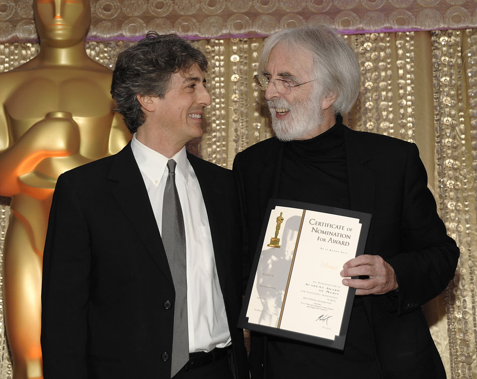 Photo - Director Alexander Payne, left, and director Michael Haneke pose together during the The Oscars Foreign Language Film Award Directors Reception at The Academy of Motion Picture Arts and Sciences in Beverly Hills, Calif. on Friday, Feb. 22, 2013. Haneke's feature film