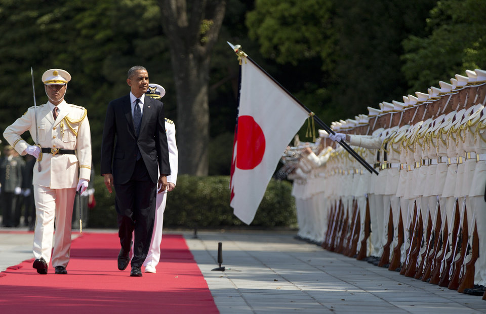 Photo - President Barack Obama, center, reviews troops during a welcome ceremony as he arrives at Imperial Palace in Tokyo, Thursday, April 24, 2014. Facing fresh questions about his commitment to Asia, Obama will seek to convince Japan's leaders Thursday that he can deliver on his security and economic pledges, even as the crisis in Ukraine demands U.S. attention and resources elsewhere. (AP Photo/Carolyn Kaster)
