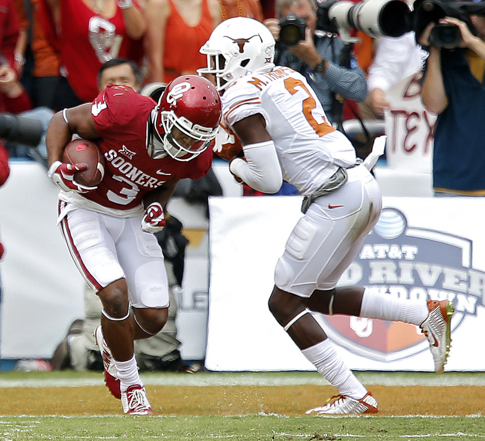 Photo - Oklahoma's Sterling Shepard (3) scores a touchdown in front of Texas' Mykkele Thompson (2) during the college football game between the University of Oklahoma Sooners (OU) and the University of Texas Longhorns (UT) during the Red River Showdown at the Cotton bowl in Dallas, Texas on Saturday, Oct. 11, 2014. Photo by Chris Landsberger, The Oklahoman