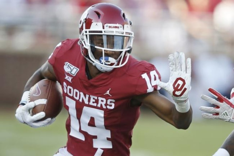 Photo -  Oklahoma wide receiver Charleston Rambo said he can do even more for the Sooners. He had five catches for 116 yards and two touchdowns in Saturday's 48-14 win over UCLA. [AP Photo/Sue Ogrocki]