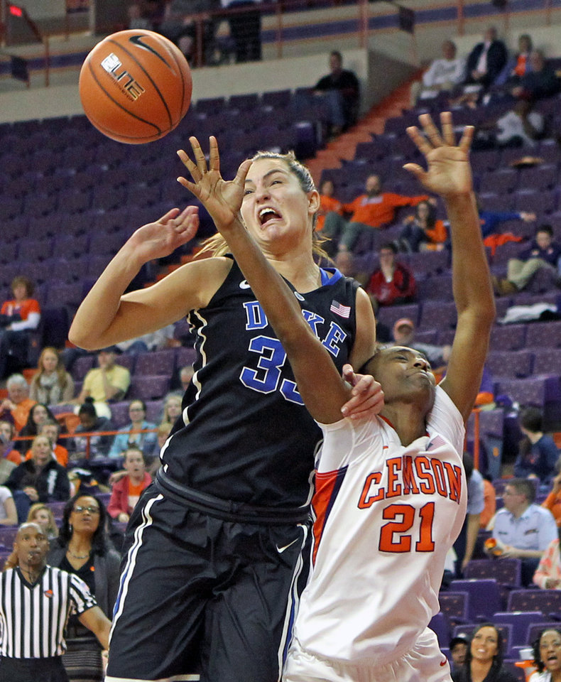 Photo - Duke's Haley Peters, left, fouls Clemson's Nikki Dixon as they fight for a rebound in the second half of an NCAA college basketball game on Thursday, Feb. 6, 2014, in Clemson, S.C. (AP Photo/Anderson Independent-Mail, Mark Crammer) GREENVILLE NEWS OUT; SENECA NEWS OUT