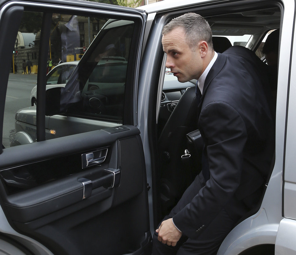 Photo - Oscar Pistorius arrives at the high court in Pretoria, South Africa, Tuesday, May 6, 2014. Using witness accounts of a panicked nighttime phone call from Pistorius begging for help and his desperate pleas for Reeva Steenkamp to stay alive, the defense at his murder trial tried to reinforce its case Monday that the double-amputee Olympian fatally shot his girlfriend in a tragic error of judgment. (AP Photo/Themba Hadebe)