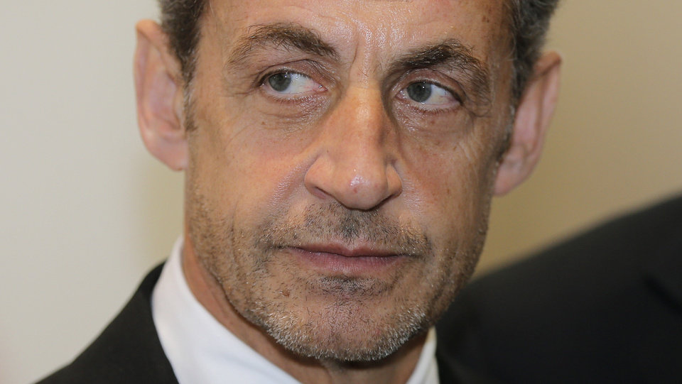 Photo - FILE - This Monday, March 10, 2014, file photo shows former French President Nicolas Sarkozy at the Foundation Claude Pompidou, in Nice, French Riviera. Former French President Nicolas Sarkozy has been detained and is reportedly being questioned by financial investigators in a corruption probe that is rattling France's conservative political establishment. (AP Photo/Lionel Cironneau, File)