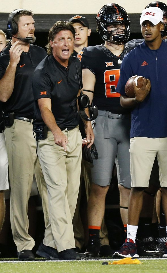 Photo - Oklahoma State coach Mike Gundy reacts to a call for targeting against OSU in the second quarter during a college football game between Oklahoma State (OSU) and South Alabama at Boone Pickens Stadium in Stillwater, Okla., Saturday, Sept. 8, 2018. Photo by Nate Billings, The Oklahoman