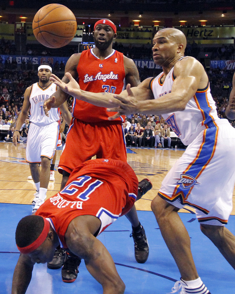 Photo - Oklahoma City's Derek Fisher (37) defends on Los Angeles Clippers point guard Eric Bledsoe (12) as Los Angeles Clippers power forward Reggie Evans (30) looks on during the NBA basketball game between the Oklahoma City Thunder and the Los Angeles Clippers at Chesapeake Energy Arena on Wednesday, March 21, 2012 in Oklahoma City, Okla.  Photo by Chris Landsberger, The Oklahoman