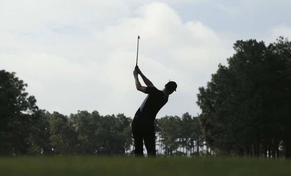 Photo - Martin Kaymer, of Germany, watches his tee shot on the 17th hole during the second round of the U.S. Open golf tournament in Pinehurst, N.C., Friday, June 13, 2014. (AP Photo/Charlie Riedel)