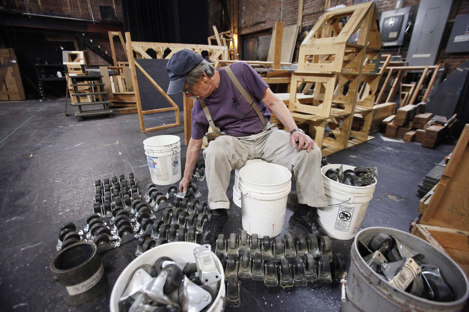 "Lance Reese sorts casters for the set of the Pollard Theatre production ""A Territorial Christmas Carol"" that opens after Thanksgiving in Guthrie. Photos by David McDaniel, The Oklahoman"