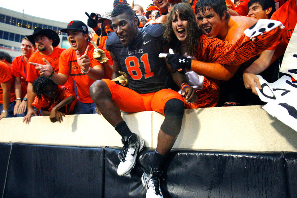 Oklahoma State\'s Justin Blackmon (81) joins the crowd in celebration after a college football game where the Oklahoma State University Cowboys (OSU) defeated the University of Kansas Jayhawks (KU) 70-28 at Boone Pickens Stadium in Stillwater, Okla., Saturday, Oct. 8, 2011