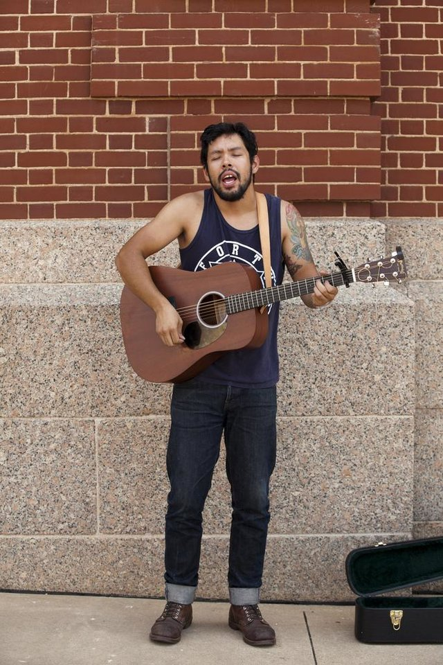 Photo - Jose Hernandez performs on the streets of Guthrie, Okla. during the Gentlemen of the Road Festival on Friday, September 6, 2013.  Nathan Poppe, for The Oklahoman