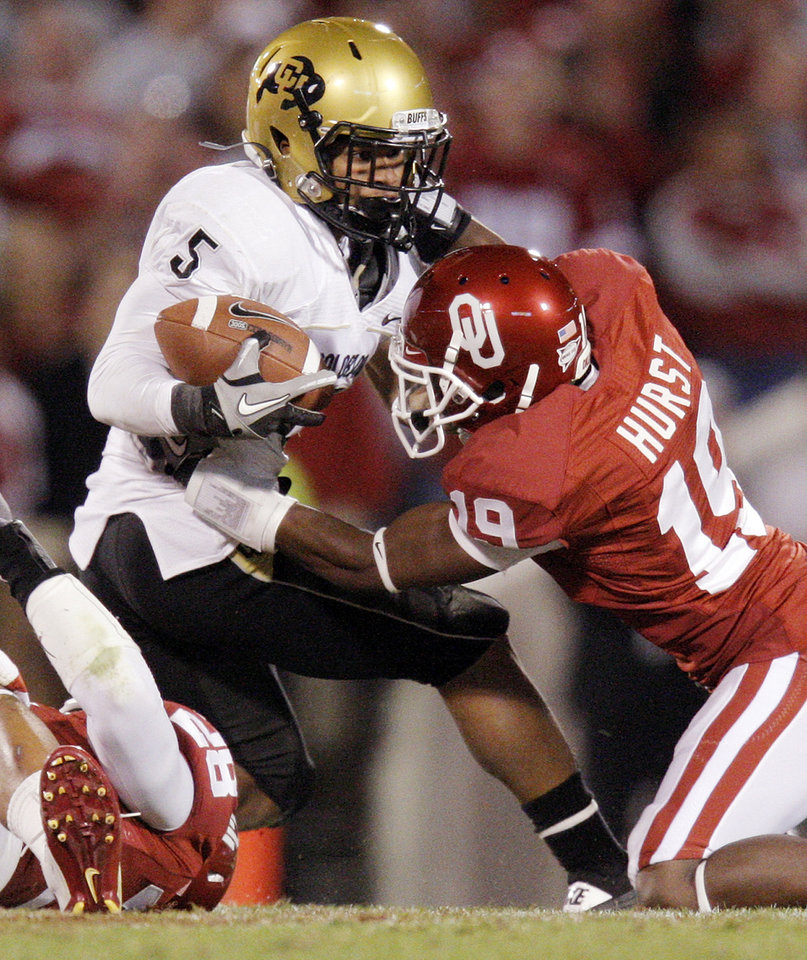 Photo - OU's Demontre Hurst (19) stops Rodney Stewart (5) of Colorado in the third quarter during the college football game between the University of Oklahoma (OU) Sooners and the University of Colorado Buffaloes at Gaylord Family-Oklahoma Memorial Stadium in Norman, Okla., Saturday, October 30, 2010. Photo by Nate Billings, The Oklahoman