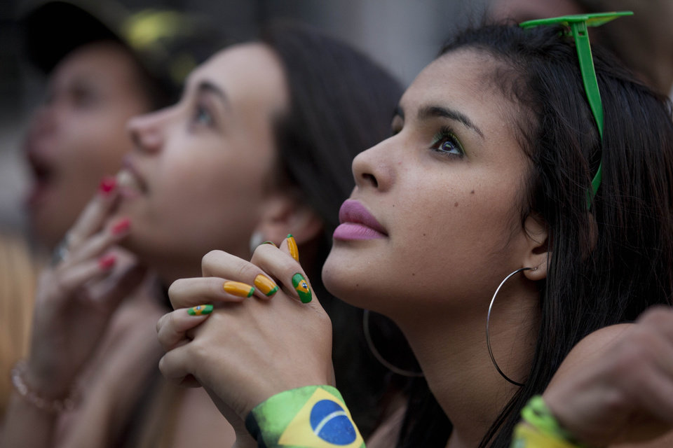 Photo - Fans watch a live telecast of the Mexico vs. Brazil match at the FIFA Fan Fest during the 2014 soccer World Cup in Sao Paulo, Brazil, Tuesday, June 17, 2014. Mexico claimed a deserved point against Brazil in a largely frustrating Group A game which finished 0-0 at Estadio Castelao in Fortaleza. (AP Photo/Dario Lopez-Mills)