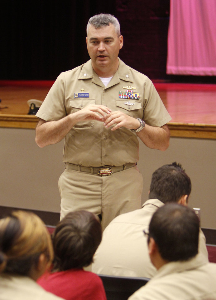 Photo - Students listen to Commanding Officer Andrew Peterson, as the crew of USS Oklahoma City submarine meets with the Navy ROTC at Capitol Hill High School on Thursday. PHOTO BY PAUL HELLSTERN, THE OKLAHOMAN  PAUL HELLSTERN - Oklahoman