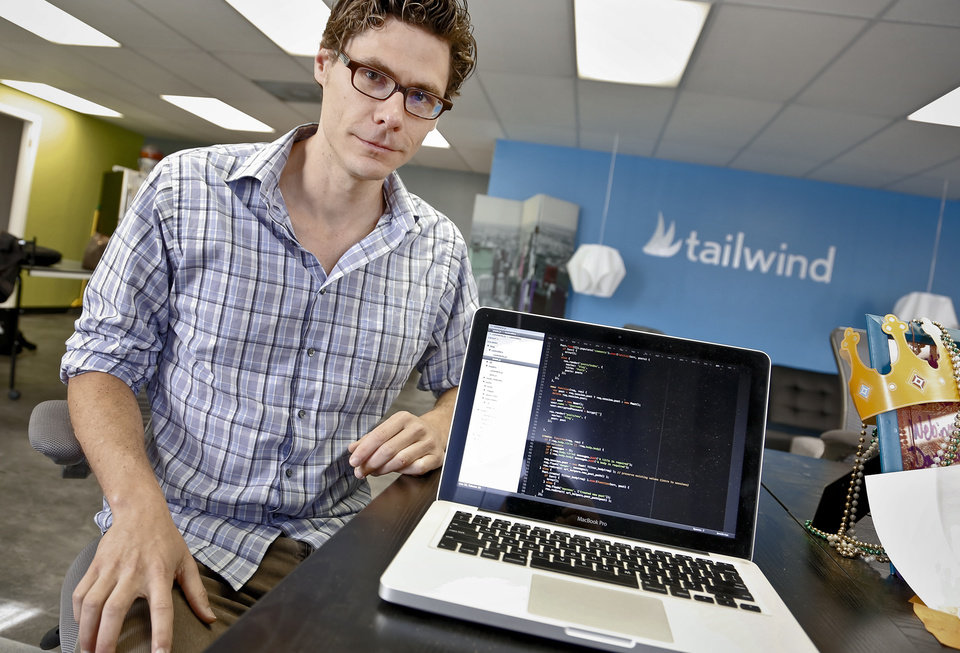 Photo -  Philip Dow poses for a photo at Oklahoma City-based tech startup company Tailwind Analytics.    CHRIS LANDSBERGER -  CHRIS LANDSBERGER