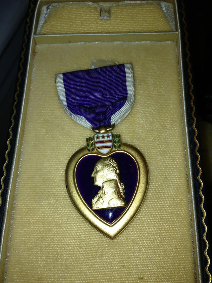Photo - In this photo provided by Donna Gregory is the Purple Heart medal awarded to Pfc. John Farrell Eddington who was killed in action in Italy during World War II. About 14 years ago Donna Gregory was cleaning out a St. Louis home and found a box containing Eddington's medal and a letter to the daughter he never met. Gregory spent years searching for Eddington's daughter and the with help of Facebook, she'll return the medal and letter to Peggy Smith during a ceremony  Saturday, Sept. 21, 2013, in Dayton, Nev. (AP Photo/Courtesy Donna Gregory)