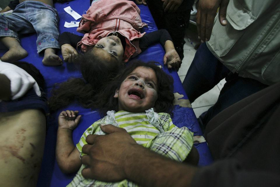 Photo - Palestinian children wounded in Israeli shelling are treated in a hospital in Rafah in the southern Gaza Strip, Friday, Aug. 1, 2014. (AP Photo/Eyad Baba)