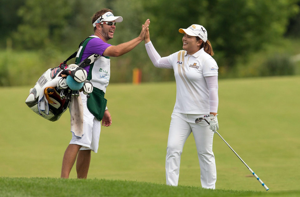 Photo - Inbee Park, right, celebrates her eagle on the 10th hole with her caddy during the final round of the Manulife Financial LPGA Classic golf tournament in Waterloo, Ontario, Sunday, July 14, 2013. (AP Photo/The Canadian Press, Geoff Robins)