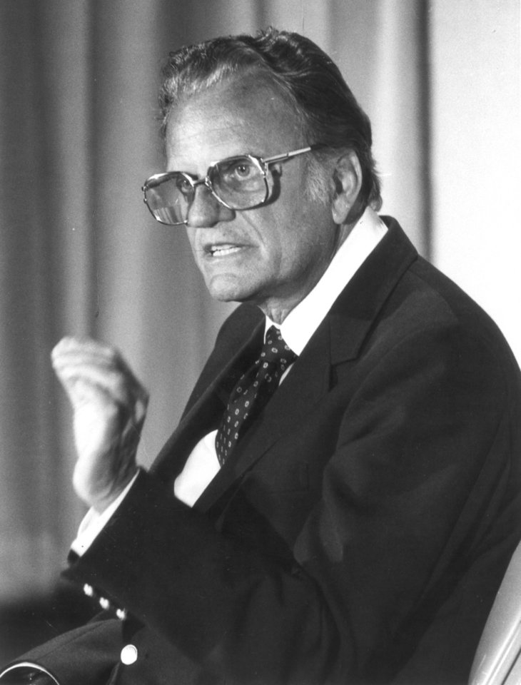 Photo - Evangelist Billy Graham, shown at a news conference in Oklahoma City Thursday, is concerned about what he sees as the deterioration of the American family. The Billy Graham Crusade runs Sunday through Oct. 30 at the Myriad Convention Center. Evangelist Billy Graham in Oklahoma City.  Staff photo by Jim Argo taken 10/20/1983.