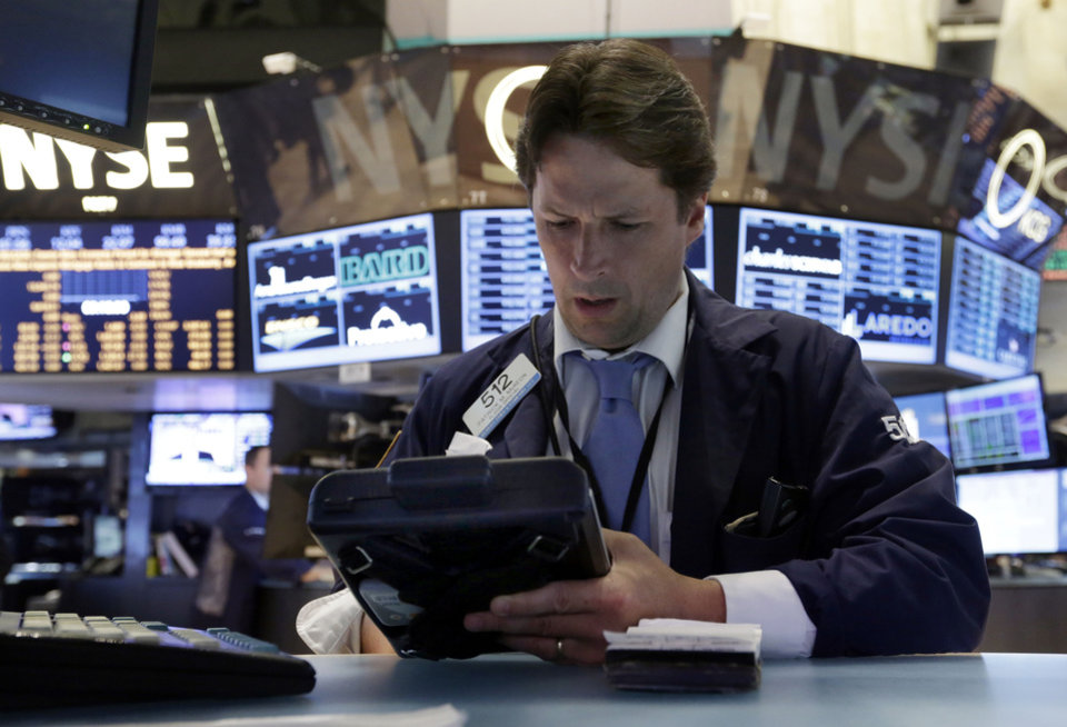 Photo - Trader Patrick McKeon works on the floor of the New York Stock Exchange Monday, July 22, 2013. The stock market edged higher as a big week of earnings kicked off Monday as the results from a handful of large U.S. companies were mixed. (AP Photo/Richard Drew)