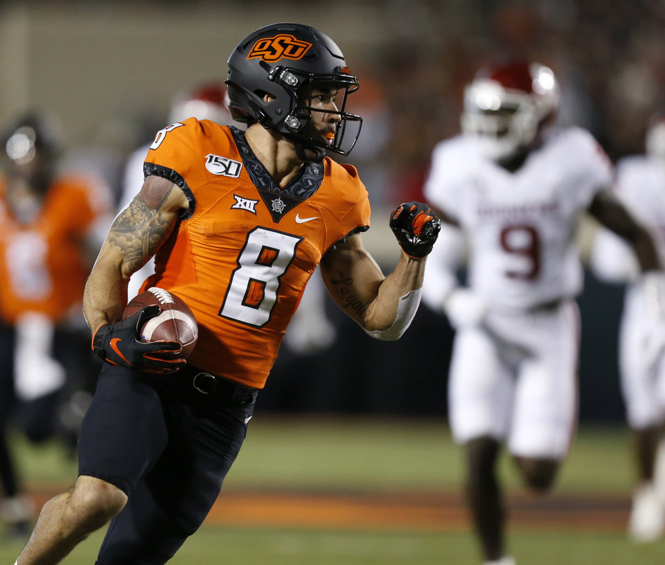 Photo - Oklahoma State's Braydon Johnson (8) runs after a catch in the first quarter during the Bedlam college football game between the Oklahoma State Cowboys (OSU) and Oklahoma Sooners (OU) at Boone Pickens Stadium in Stillwater, Okla., Saturday, Nov. 30, 2019. [Nate Billings/The Oklahoman]