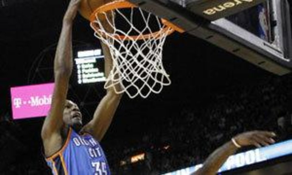 Oklahoma City Thunder's Kevin Durant (35) goes to the basket as Miami Heat's LeBron James, right, defends in the first quarter of an NBA basketball game in Miami, Wednesday, March 16, 2011. (AP Photo)