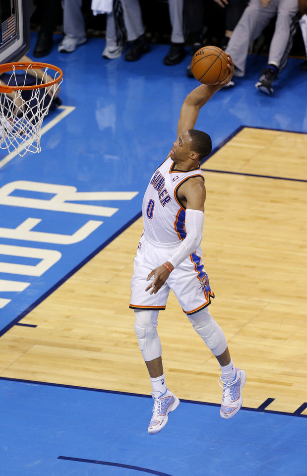 Photo - Oklahoma City's Russell Westbrook (0) goes up for a dunk during Game 4 of the Western Conference Finals in the NBA playoffs between the Oklahoma City Thunder and the San Antonio Spurs at Chesapeake Energy Arena in Oklahoma City, Tuesday, May 27, 2014. PHOTO BY BRYAN TERRY, The Oklahoman