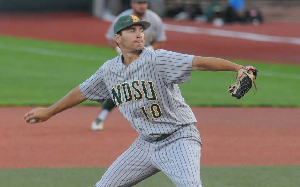 Photo - North Dakota State's David Ernst delivers a pitch during the second inning against Oregon State in an NCAA college baseball tournament regional game in Corvallis, Ore., Friday, May 30, 2014. (AP Photo/Mark Ylen)