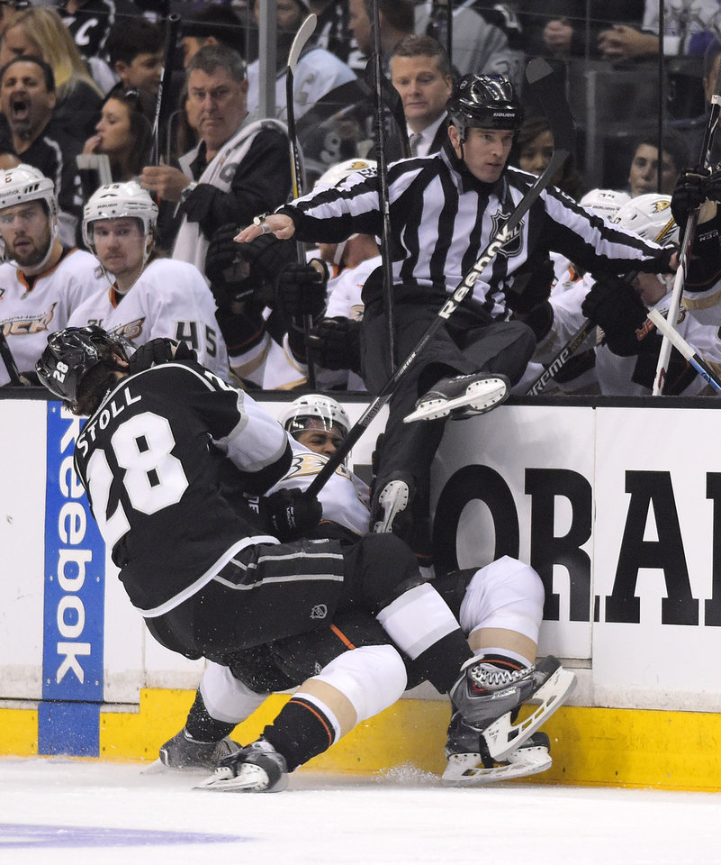Photo - Los Angeles Kings center Jarret Stoll, left, and Anaheim Ducks right wing Devante Smith-Pelly collide during the first period in Game 4 of an NHL hockey second-round Stanley Cup playoff series, Saturday, May 10, 2014, in Los Angeles. (AP Photo/Mark J. Terrill)