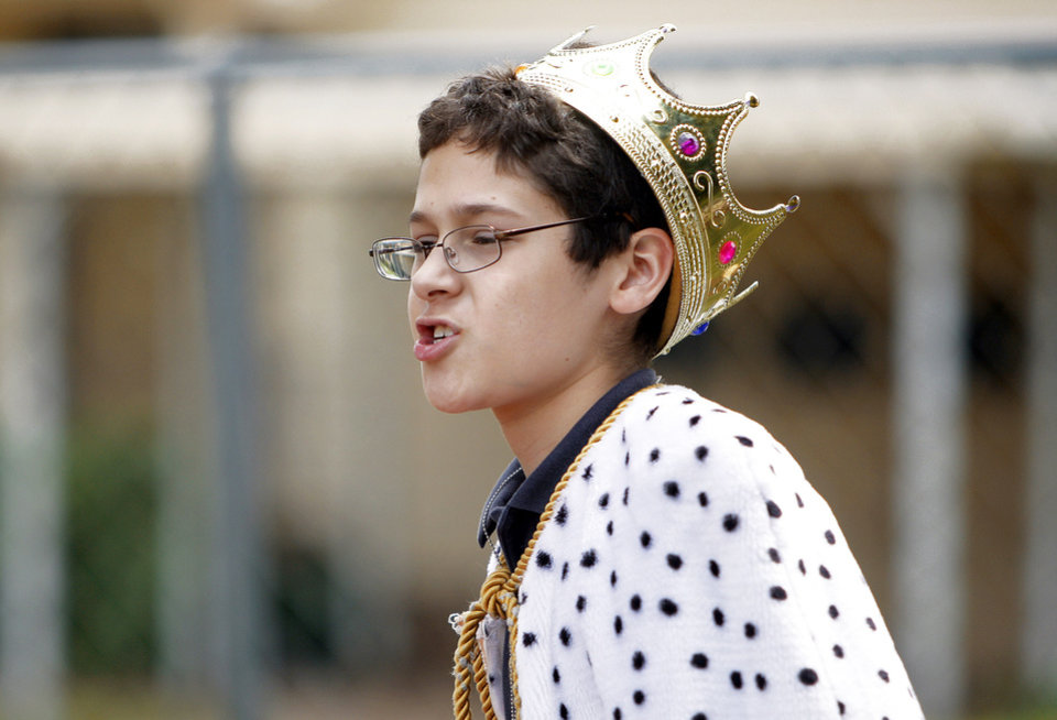 Photo - Jace Pevey runs the jousting station during a medievel fair on Tuesday