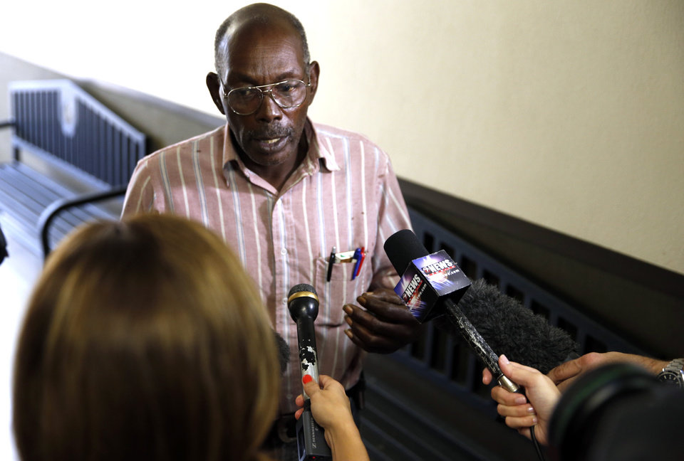 Photo - CHRISTOPHER LANE MURDER: James Edwards Sr, father of one of three teenage suspects, speaks with the media as he waits to enter the courtroom before the three are arraigned in the shooting death of Christopher Lane on Tuesday, Aug. 20, 2013 in Duncan, Okla.  Photo by Steve Sisney, The Oklahoman