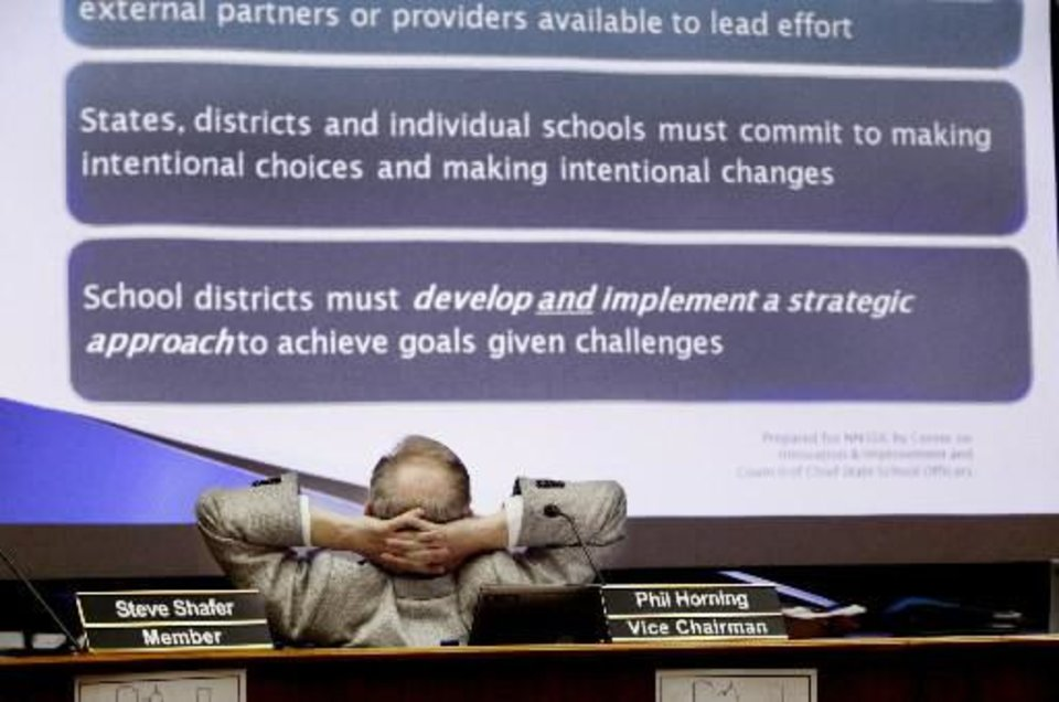 Photo - Oklahoma  City  Public  Schools Board Vice-Chairman Phil Horning watches a slideshow outlining options regarding U.S. Grant High  School during Monday night's board meeting at the administration  building in  Oklahoma City, March 22, 2010. Photo by Jim Beckel