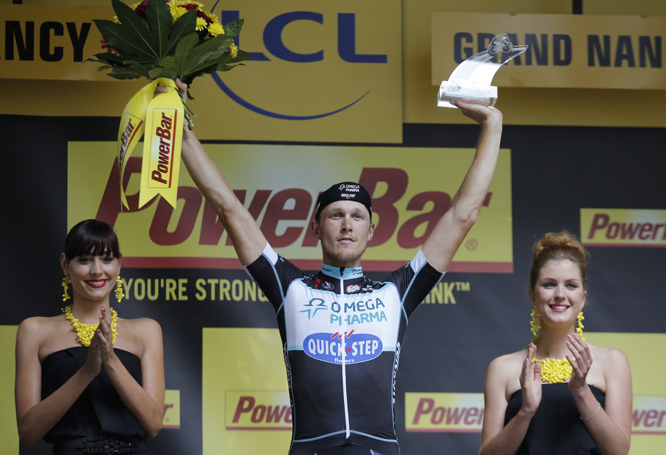 Photo - Stage winner Italy's Matteo Trentin celebrates on the podium of the  seventh stage of the Tour de France cycling race over 234.5 kilometers (145.7 miles) with start in Epernay and finish in Nancy, France, Friday, July 11, 2014. (AP Photo/Christophe Ena)