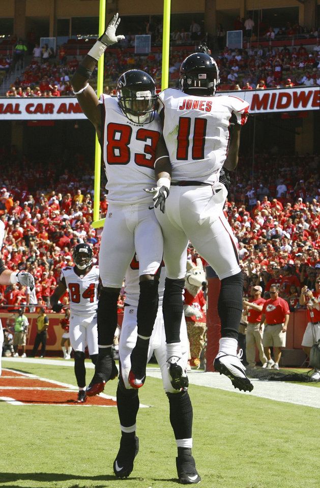 Photo -   Atlanta Falcons wide receiver Julio Jones (11) celebrates his touchdown with teammate Harry Douglas (83) during the first half of an NFL football game against the Atlanta Falcons at Arrowhead Stadium in Kansas City, Mo., Sunday, Sept. 9, 2012. (AP Photo/Ed Zurga)