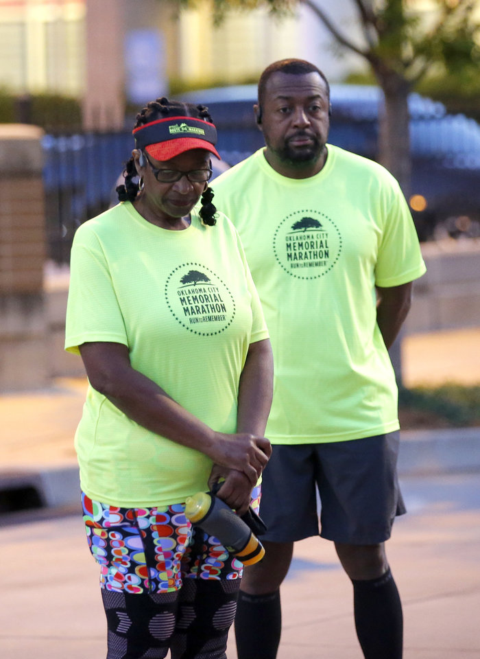 Photo - Deb and Barry Carrington pause for a 168 seconds of silence before running the half marathon course of the Oklahoma City Memorial Marathon in Oklahoma City,  Sunday, April 26, 2020.  The 20th Oklahoma City Memorial Marathon was delayed until October because of Covid-19. [Sarah Phipps/The Oklahoman]