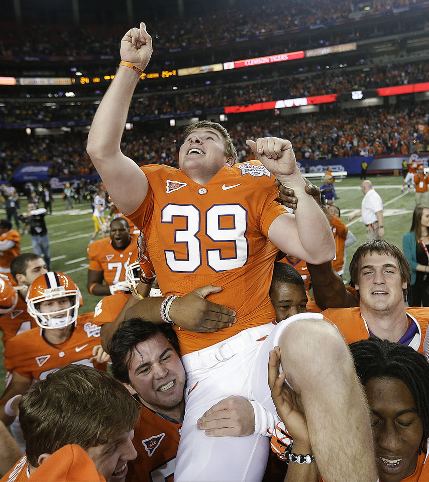Clemson kicker Chandler Catanzaro is hoisted after he kicked the winning 37-yard field goal as time expired in the Chick-fil-A Bowl NCAA college football game against LSU, Monday, Dec. 31, 2012, in Atlanta. Clemson won 25-24.  (AP Photo/David Goldman)