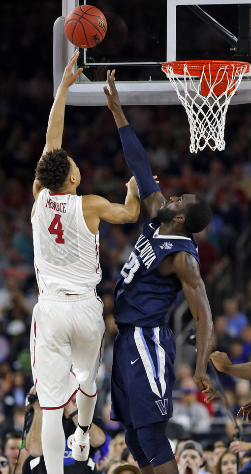 Photo - Oklahoma's Jamuni McNeace (4) shoots against Villanova's Daniel Ochefu (23) during the national semifinal between the Oklahoma Sooners (OU) and the Villanova Wildcats in the Final Four of the NCAA Men's Basketball Championship at NRG Stadium in Houston, Saturday, April 2, 2016. Photo by Nate Billings, The Oklahoman