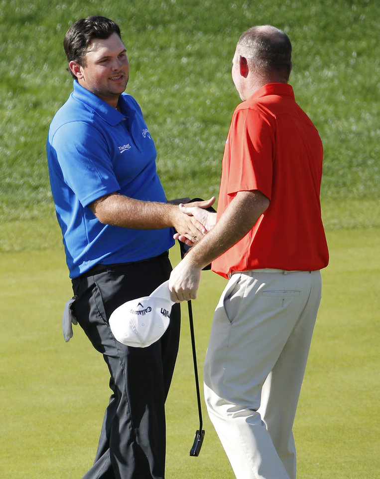 Photo - Patrick Reed, left, greets Tommy Gainey on the ninth tee after finishing their third round of the Humana Challenge PGA golf tournament on the Nicklaus Private course at PGA West, Saturday, Jan. 18, 2014, in La Quinta, Calif. Reed shot a 9-under par for the third day in a row and is 27-under par going into the final round.  (AP Photo/Matt York)