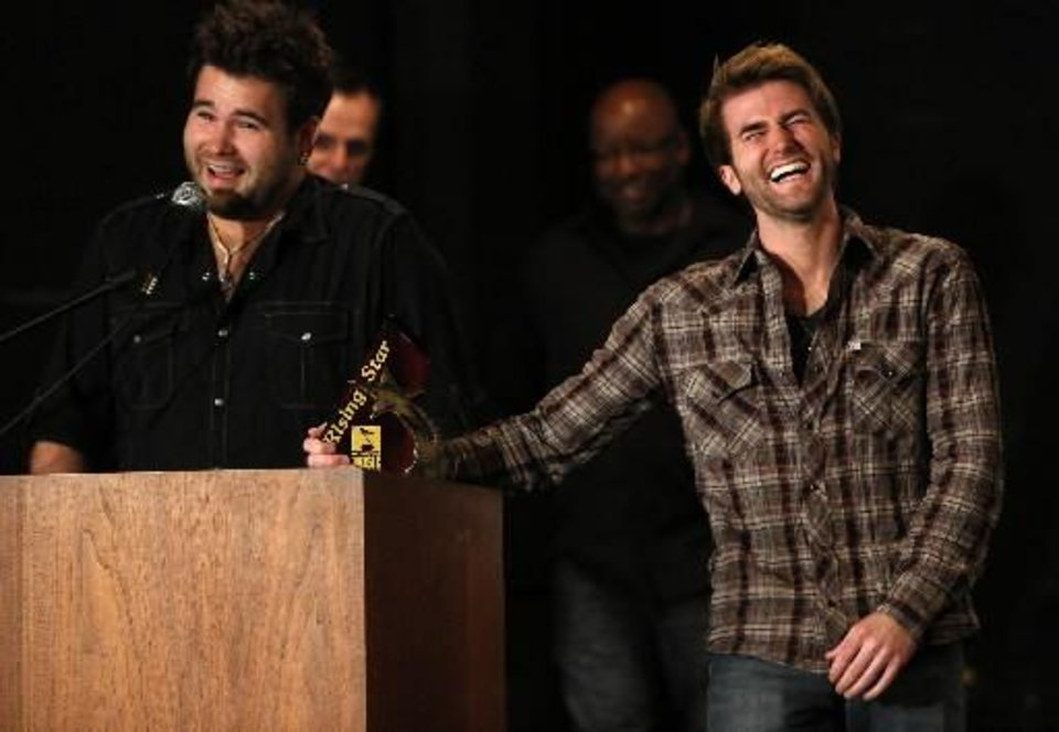 Photo -  The Swon Brothers, from left, Zach and Colton Swon, receive the Oklahoma Music Hall of Fame Rising Star award in Muskogee, Okla., Thursday, June 6, 2013. Photo by Garett Fisbeck/Tulsa World