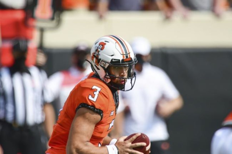 Photo -  Oklahoma State's Spencer Sanders has played only two possessions this season, suffering an ankle injury in the season opener against Tulsa. [AP Photo/Brody Schmidt]