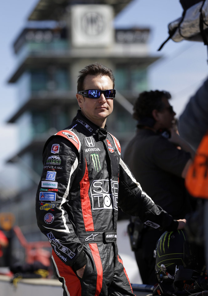 Photo - Race driver Kurt Busch waits in the pit area for the start of practice at the Indianapolis Motor Speedway during the Rookie Orientation Program in Indianapolis, Tuesday, April 29, 2014. Busch will try to be the first driver in a decade to compete in IndyCar's Indianapolis 500 auto race and Sprint Cup's Coca-Cola 600 on the same day. (AP Photo/Michael Conroy)