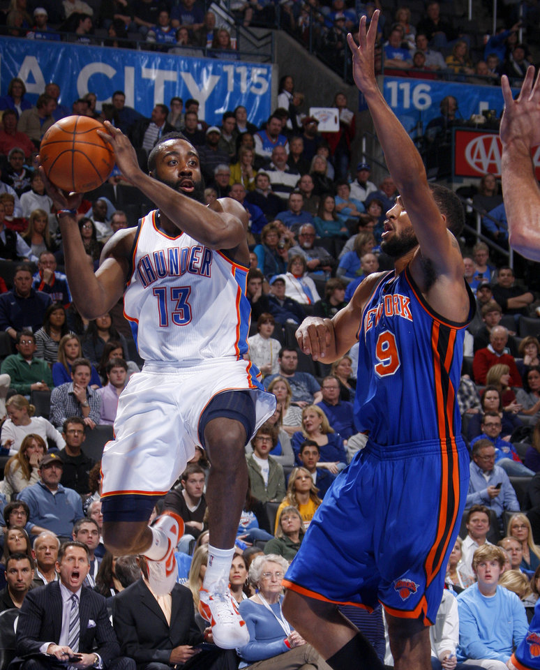 Oklahoma City's James Harden (13) looks to pass the ball beside New York's Jared Jeffries (9) during the NBA game between the Oklahoma City Thunder and the New York Knicks at Chesapeake Energy Arena in Oklahoma CIty, Saturday, Jan. 14, 2012. Photo by Bryan Terry, The Oklahoman