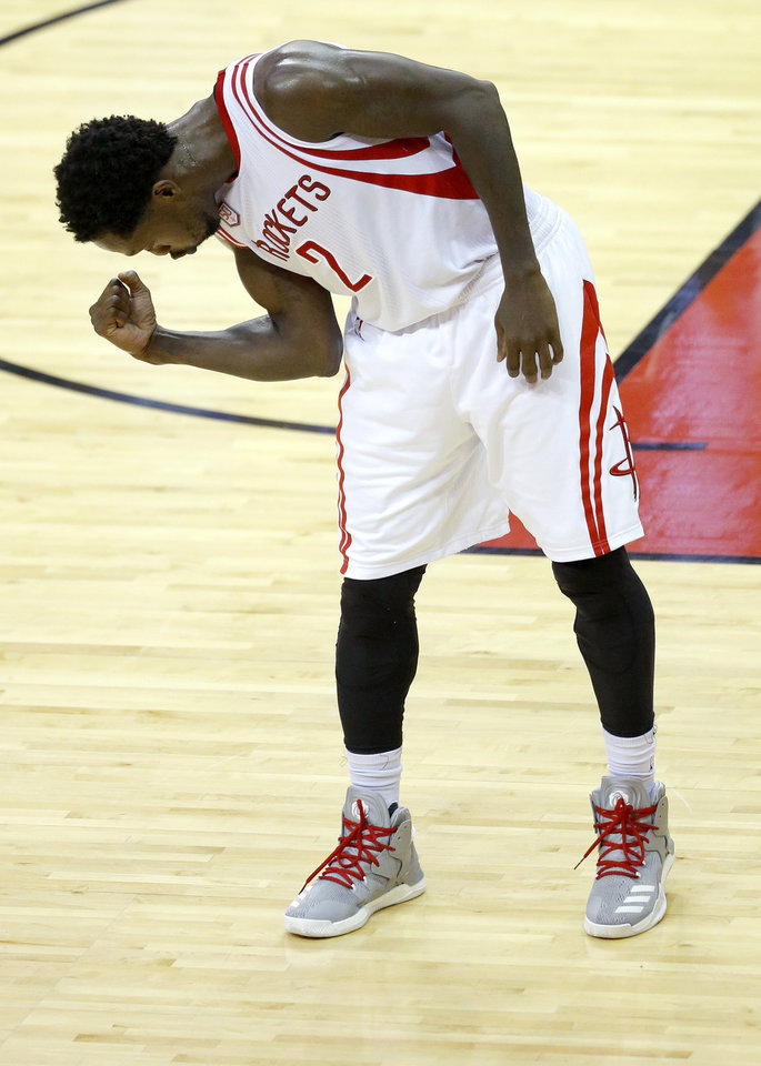 Photo - Houston's Patrick Beverley (2) celebrates a basket during Game 5 in the first round of the NBA playoffs between the Oklahoma City Thunder and the Houston Rockets in Houston, Texas,  Tuesday, April 25, 2017.  Photo by Sarah Phipps, The Oklahoman