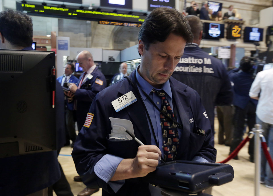 Photo - Trader Patrick McKeon works on the floor of the New York Stock Exchange Tuesday, May 27, 2014. Stocks rose Tuesday after the government reported that orders for big-ticket items rose unexpectedly last month. (AP Photo/Richard Drew)