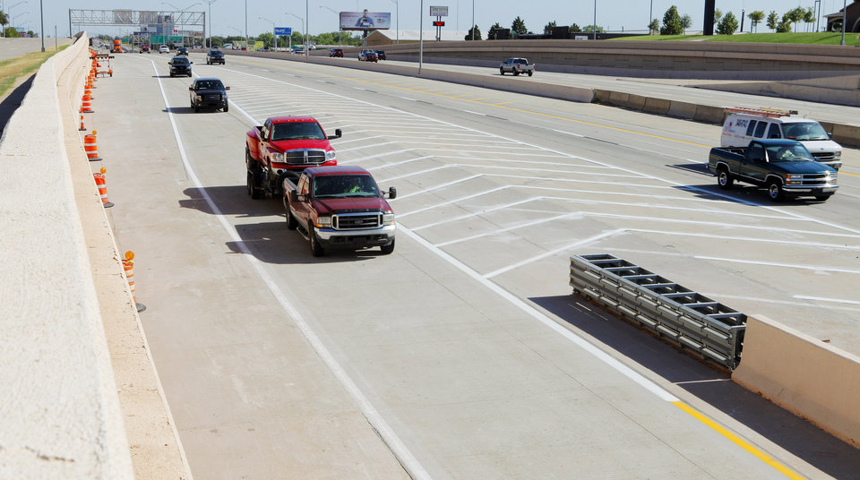 Vehicles at left taking the new exit ramp to go from southbound I-235 to westbound I-44 in Oklahoma City Friday July 20, 2012. Photo by Paul B. Southerland, The Oklahoman