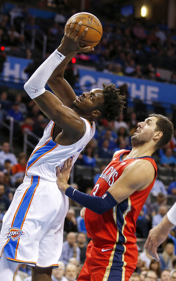 Photo - Oklahoma City's Jerami Grant (9) takes a shot in front of New Orleans' Nikola Mirotic (3) during an NBA basketball game between the Oklahoma City Thunder and the New Orleans Pelicans at Chesapeake Energy Arena in Oklahoma City, Monday, Nov. 5, 2018. Photo by Nate Billings, The Oklahoman