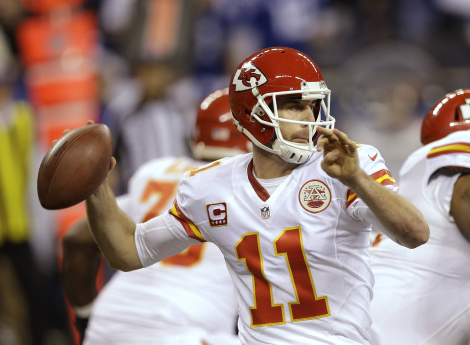 Photo - Kansas City Chiefs quarterback Alex Smith (11) throws against the Indianapolis Colts during the first half of an NFL wild-card playoff football game Saturday, Jan. 4, 2014, in Indianapolis. (AP Photo/Michael Conroy)