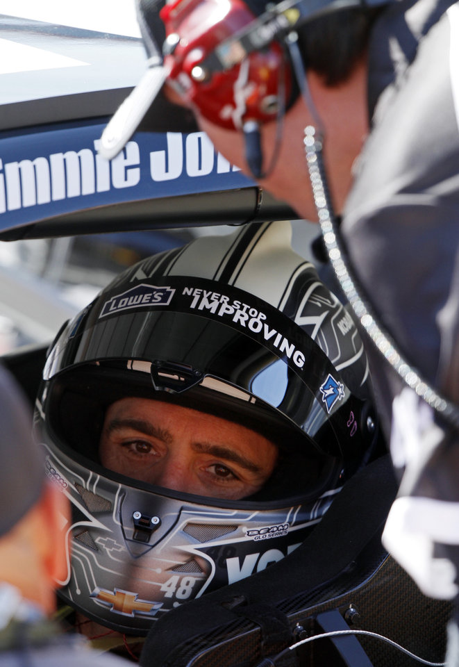 Photo - Driver Jimmie Johnson (48) talks to teammates before practice for the NASCAR Sprint Cup series auto race at Bristol Motor Speedway on Friday, March 14, 2014, in Bristol, Tenn. (AP Photo/Wade Payne)